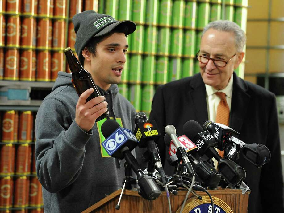 U.S. Senator Charles Schumer, right, listens to Alejandro Del Peral, founder of Nine Pin Ciderworks, explain how the recently passed CIDER Act will help his business and boost the Capital RegionOs and Upstate New YorkOs growing hard cider industry during a press conference at Nine Pin Ciderworks  on Tuesday, Jan. 5, 2016 in Albany, N.Y.  (Lori Van Buren / Times Union) Photo: Lori Van Buren / 10034871A