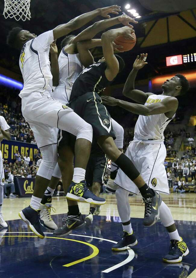 Colorado guard George King, center, is defended by California forward Jaylen Brown, left, center Kingsley Okoroh, second from left, and guard Jabari Bird during the first half of an NCAA college basketball game in Berkeley, Calif., Friday, Jan. 1, 2016. (AP Photo/Jeff Chiu) Photo: Jeff Chiu / Associated Press / AP
