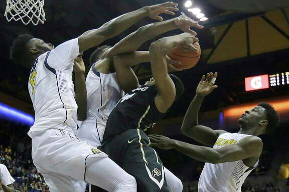 Colorado guard George King, center, is defended by California forward Jaylen Brown, left, center Kingsley Okoroh, second from left, and guard Jabari Bird during the first half of an NCAA college basketball game in Berkeley, Calif., Friday, Jan. 1, 2016. (AP Photo/Jeff Chiu)