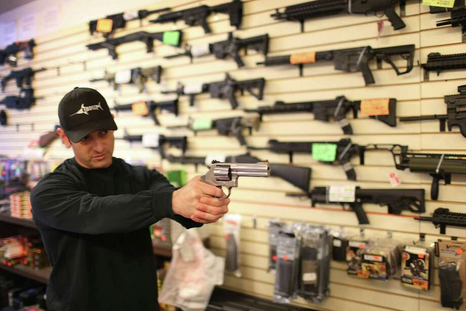 DELRAY BEACH, FL - JANUARY 05:  Brandon Wexler shows a customer one of the weapons that she was picking up at the end of the three day waiting period at the K&W Gunworks store on the day that U.S. President Barack Obama in Washington, DC announced his executive action on guns on January 5, 2016 in Delray Beach, Florida.  President Obama announced several measures that he says are intended to advance his gun safety agenda.  (Photo by Joe Raedle/Getty Images) *** BESTPIX *** Photo: Joe Raedle, Staff / 2016 Getty Images