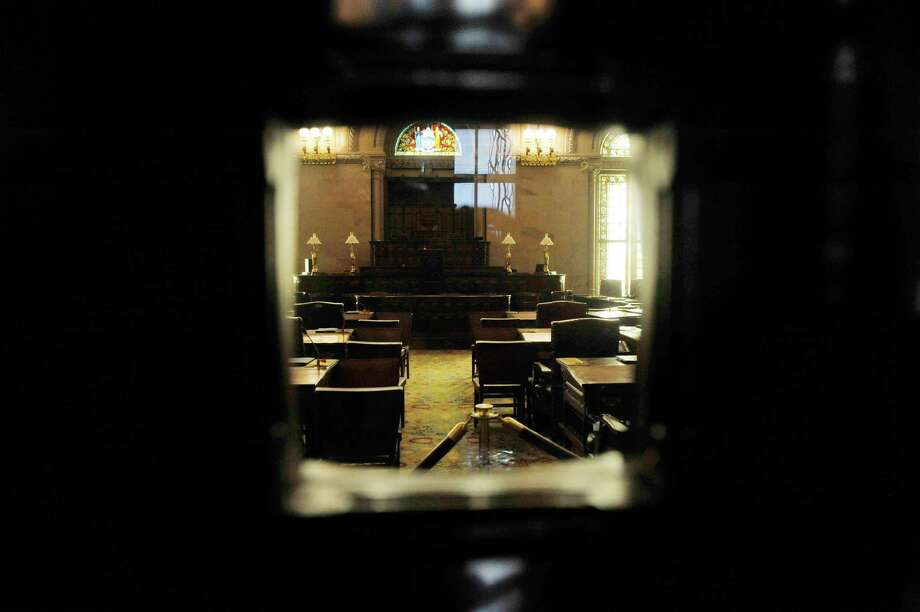 A view looking through a small window in a door of the New York State Senate chambers on Tuesday, Jan. 5, 2016, in Albany, N.Y.  The legislative session begins on Wednesday.    (Paul Buckowski / Times Union) Photo: PAUL BUCKOWSKI / 10034864A