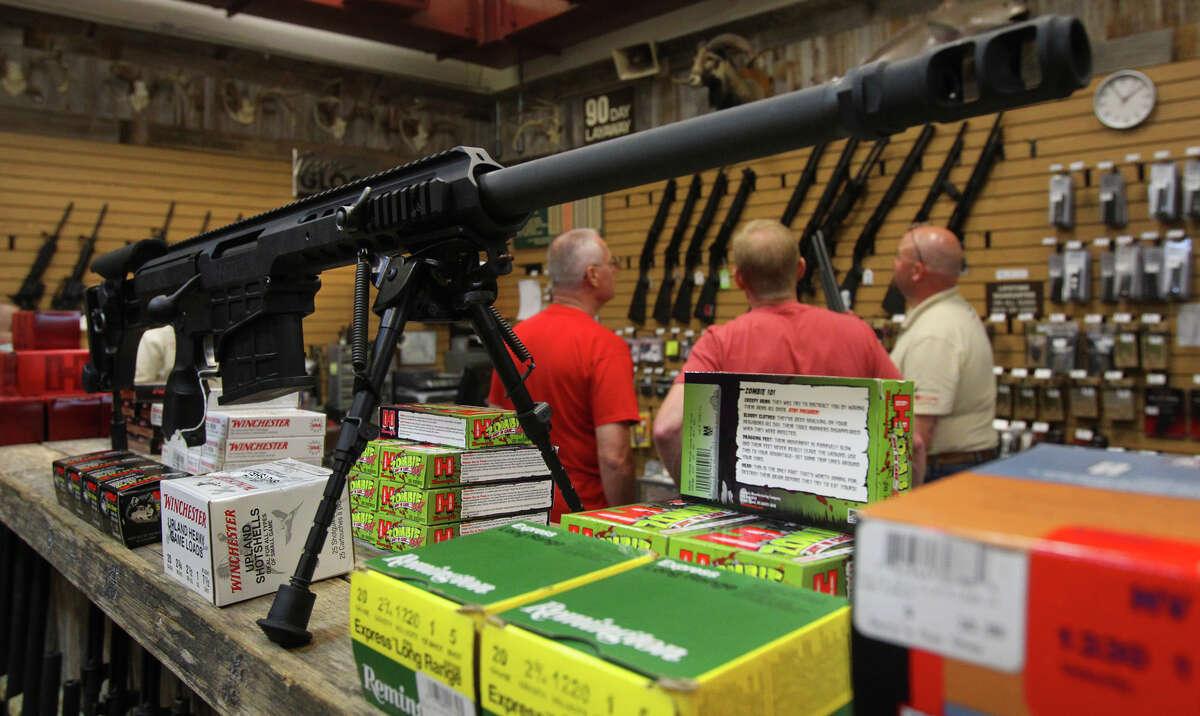 A Barrett M98B rifle is displayed at Dury's Gun Shop on Hot Wells. Johnny Dury, an owner of the store, worries new rules could bar, for example, a veteran with PTSD from buying a gun.
