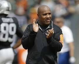 FILE - In this Sept. 13, 2015, file photo, Cincinnati Bengals offensive coordinator Hue Jackson watches as players warm up before an NFL football game against the Oakland Raiders, in Oakland, Calif. The Associated Press will announce its 2015 NFL award winners the night before the Super Bowl. Among the dozen or so noteworthy assistant coach candidates from the first half of the season, two stand out: Broncos defensive coordinator Wade Phillips and Bengals offensive coordinator Hue Jackson. (AP Photo/Ben Margot, File)