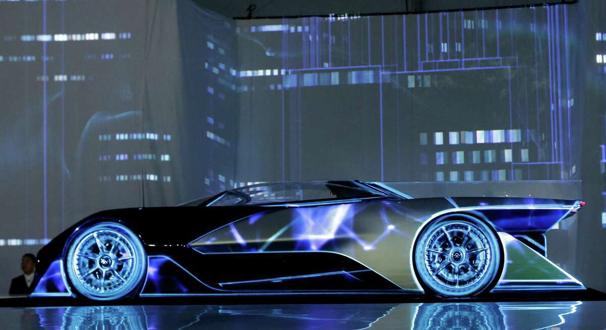 The FFZero1 by Faraday Future is displayed at CES Unveiled, a media preview event for CES International Monday, Jan. 4, 2016, in Las Vegas. The high performance electric concept car was unveiled during a news conference by Faraday Future. (AP Photo/Gregory Bull)