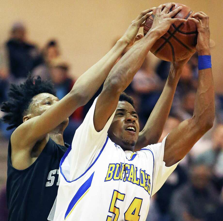 Buffalo forward Newachyah Hawkins claims a defensive rebound against Gerald Liddell as Clemens hosts Steele in boys basketball at Clemens High School gym on January 5, 2016. Photo: TOM REEL, STAFF / SAN ANTONIO EXPRESS-NEWS / 2016 SAN ANTONIO EXPRESS-NEWS