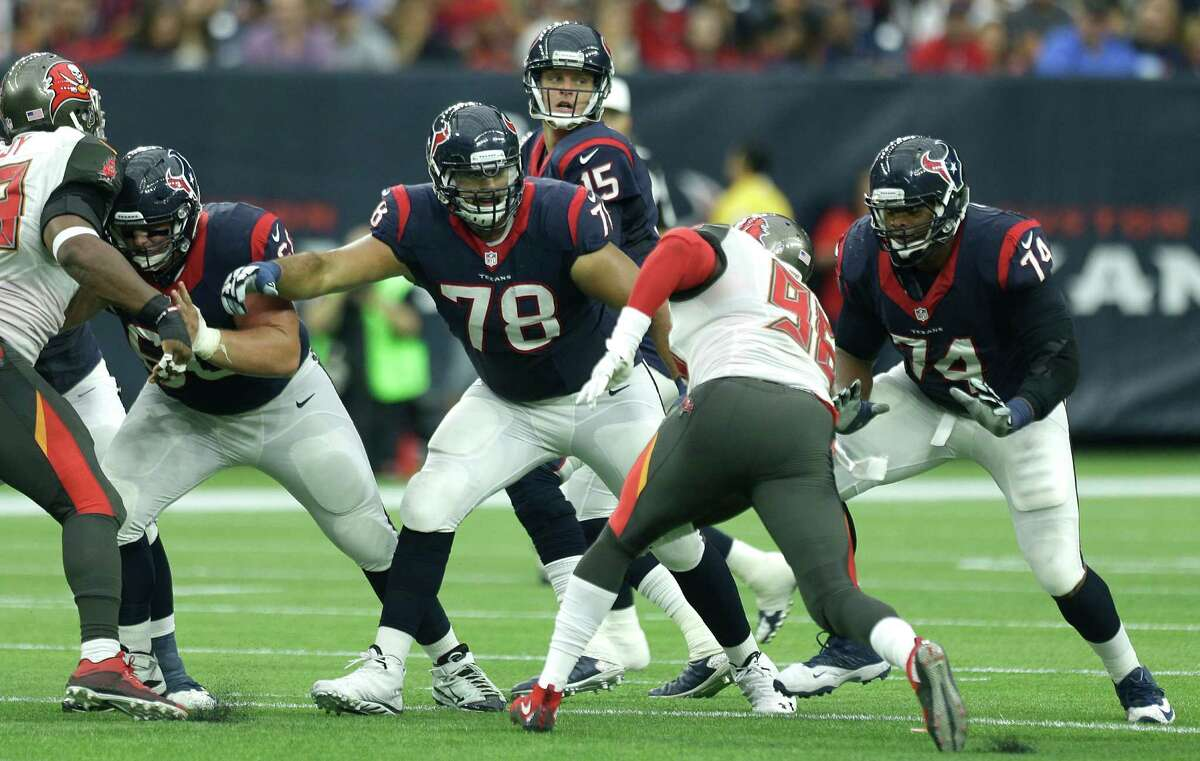 Houston Texans quarterback Ryan Mallett (15) is protected by center Ben Jones (60), guard Oday Aboushi and tackle Chris Clark (74) as he drops back to pass against the Tampa Bay Buccaneers during the first quarter of an NFL football game at NRG Stadium on Sept. 27, 2015, in Houston.