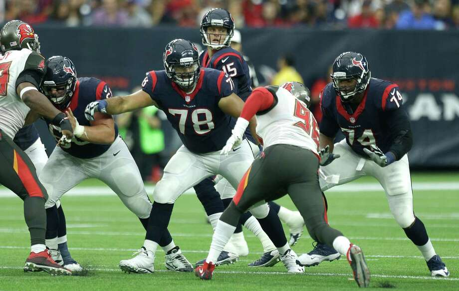 Houston Texans quarterback Ryan Mallett (15) is protected by center Ben Jones (60), guard Oday Aboushi and tackle Chris Clark (74) as he drops back to pass against the Tampa Bay Buccaneers during the first quarter of an NFL football game at NRG Stadium on Sept. 27, 2015, in Houston. Photo: Brett Coomer /Houston Chronicle / © 2015  Houston Chronicle