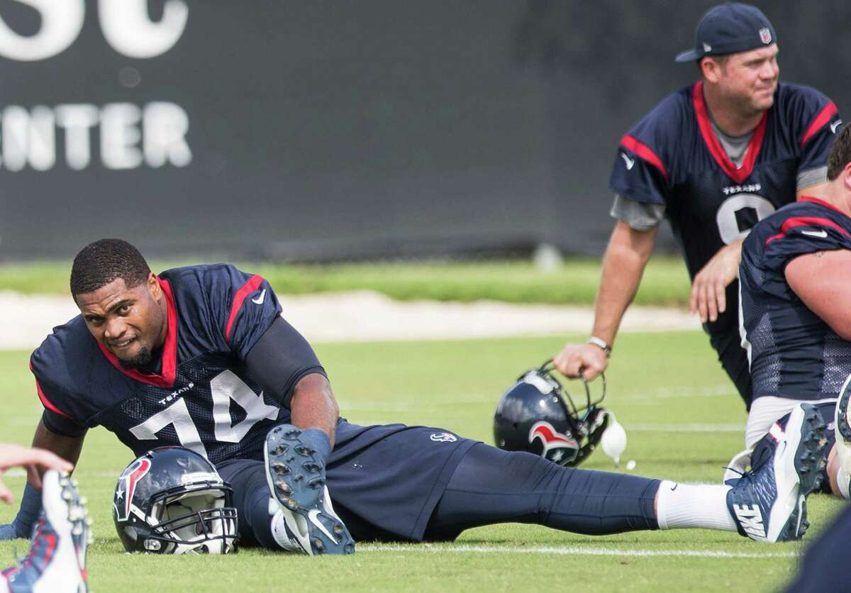 Houston Texans tackle Chris Clark (74) and punter Shane Lechler (9) stretch during practice at the Methodist Training Center on Sept. 16, 2015, in Houston.