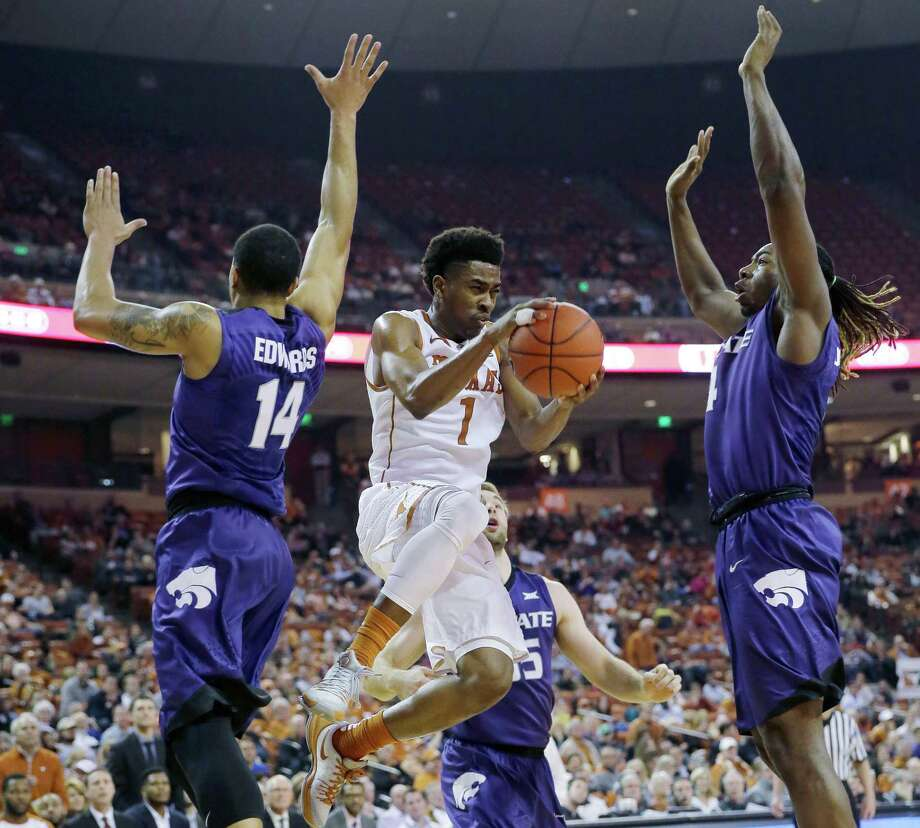 Texas guard Isaiah Taylor drives between Kansas State defenders Justin Edwards (14) and D.J. Johnson during the second half on Jan. 5 in Austin. Photo: Eric Gay /Associated Press / AP