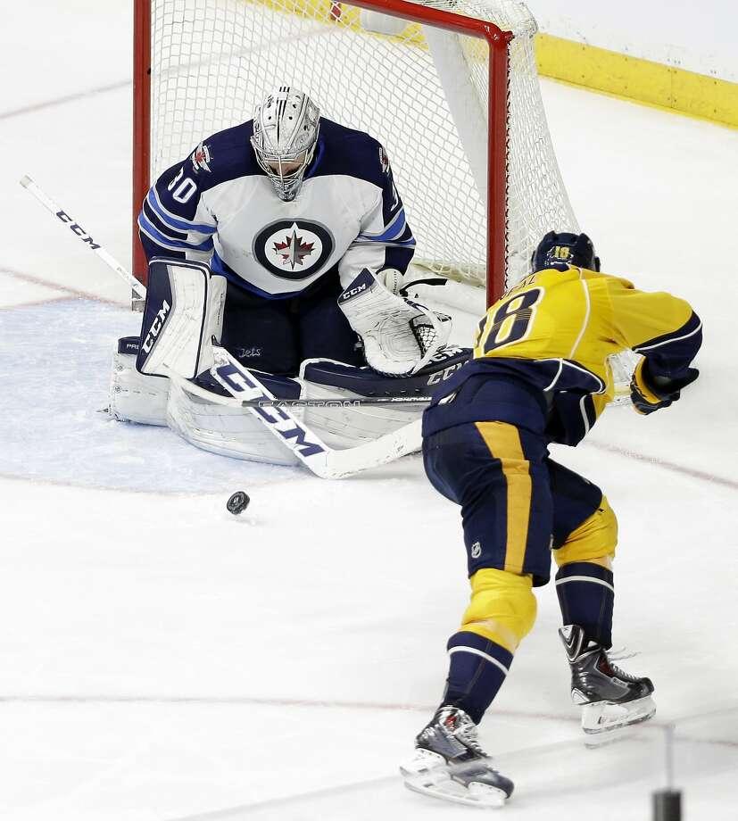 Winnipeg Jets goalie Connor Hellebuyck blocks Predators left wing James Neal in the third period. Photo: Mark Humphrey, Associated Press