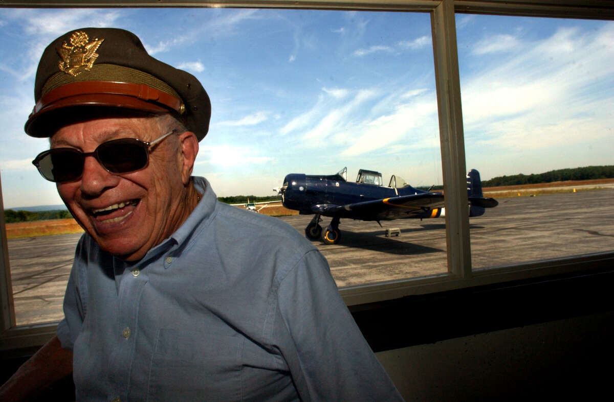 WWII veteran Milton Klarsfeld of Slingerlands is all grins after his North American Top Gun flight Saturday, Sept. 14, 2002, at Saratoga County Airport in Milton, N.Y. Klarsfeld got to re-live his flying days as a WWII navigator when he co-piloted a WWII replica airplane, seen in the background. (Cindy Schultz/Times Union archive)