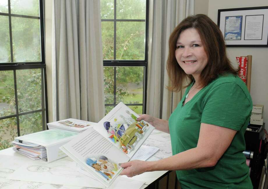 """Bellaire resident Cathey Graham Nickell has released her first children's picture book, """"Arthur Zarr's Amazing Art Car."""" Nickell says she has always been a writer, but only recently decided to work on books for little ones. Photo: George Wong / George Wong -Freelance"""