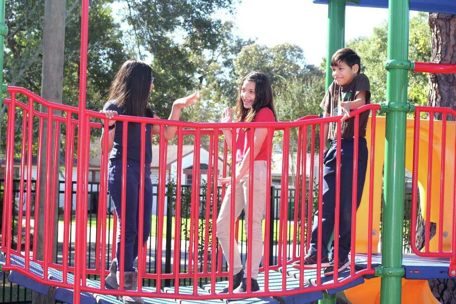Samantha Salerez, left, Melanie Govea and Rony Pawon, all 10 enjoy the new SPARK Park at Stevens Elementary. About $100,000 is being spent on upgrades to the park, which also is open to local residents. Photo: Jimmy Loyd / freelance