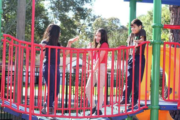 Samantha Salerez, left, Melanie Govea and Rony Pawon, all 10 enjoy the new SPARK Park at Stevens Elementary. About $100,000 is being spent on upgrades to the park, which also is open to local residents.