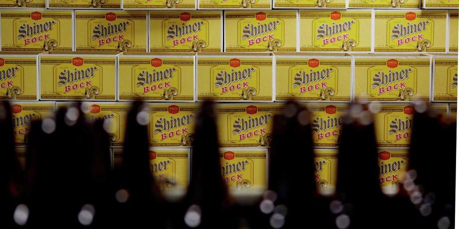 ** ADVANCE FOR WEEKEND JULY 4-5, AND THEREAFTER ** Shiner Bock is bottled at the Spoetzl Brewery, home to Shiner beers, in Shiner, Texas, Thursday, June 25, 2009. The brewery is celebrating 100 years of brewing beer. Photo: Eric Gay, AP / AP