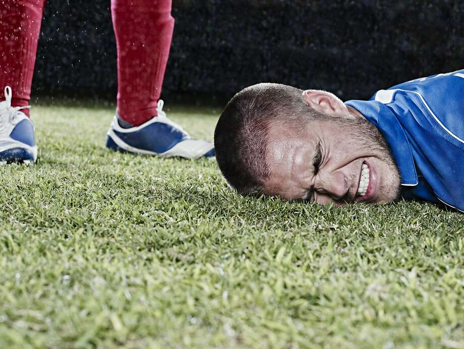 A wife doesn't know how to deal with her oft-injured soccer loving husband. Photo: Chris Ryan