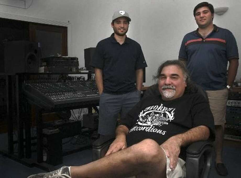 Grammy Award-winning producer Joe Trevino, with his sons Michael, 22 (left), and Andrew, 27, in Blue Cat Studio, suffered a bad laceration and concussion in a recent fall. He went to an urgent care center, but was redirected to a hospital emergency room. Photo: Express-News File Photo