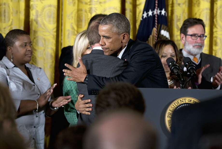 President Obama embraces Mark Barden, whose son, Daniel, died in the Newtown, Conn., shooting, as he arrives to speak about gun control measures at the White House on Tuesday. Photo: Carolyn Kaster, Associated Press