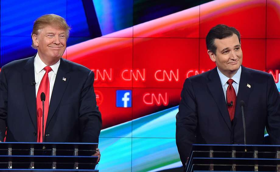 """(FILES) In this December 15, 2015 file photo, Republican presidential hopefuls Donald Trump (L) and Ted Cruz on stage at the Republican Presidential Debate, hosted by CNN, at The Venetian Las Vegas in Las Vegas, Nevada. In an interview with the Washington Post on January 5, 2016, Trump said that his rivals' birthplace could be an issue if he were to become the Republican presidential Nominee. Cruz was born in Canada, but was automatically granted American citizenship by birth because his mother was an American citizen. The US Constitution requires the president to be a """"natural born citizen."""" AFP PHOTO / ROBYN BECKROBYN BECK/AFP/Getty Images Photo: Robyn Beck, AFP / Getty Images"""