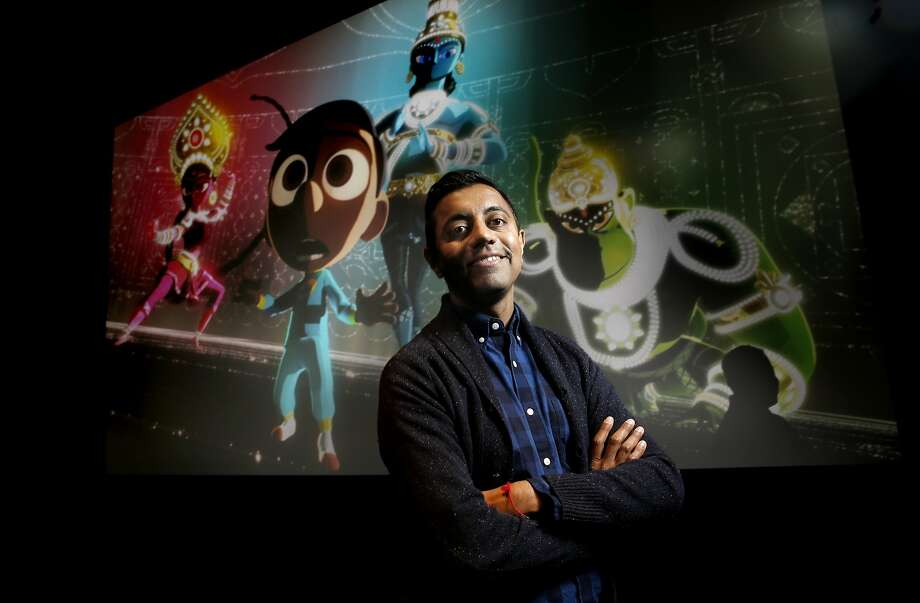"""Pixar animator and short-film director Sanjay Patel is seen with a clip from  his new short film """"Sanjay's Super-Team,"""" inside a screening room at the offices of Pixar Animation in Emeryville, Calif., on Wed. January 6, 2016. Photo: Michael Macor, The Chronicle"""