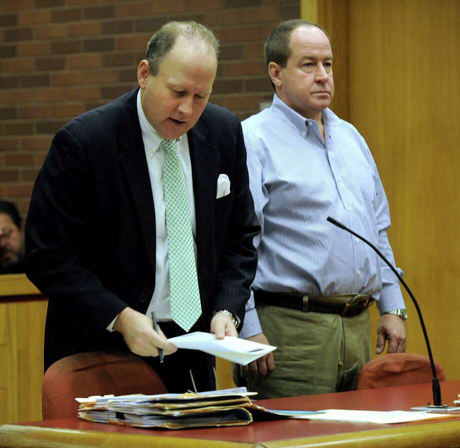 Richard Doyle, right, the pet shop owner accused of animal cruelty and witness tampering, in court in Danbury on Wednesday with his attorney, Jeffrey Jowdy. Photo: Carol Kaliff / Hearst Connecticut Media / The News-Times