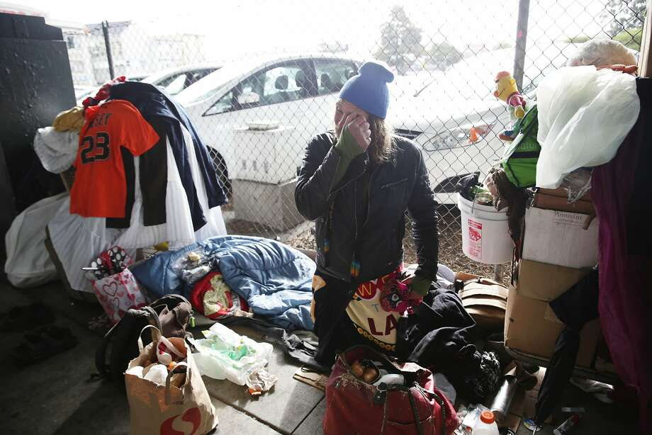 """""""The Swede"""", who has been homeless for 3 and 1/2 years, sits with some of his belongings after relocating due to the morning rain on 13th Street on Wednesday, January 6, 2015 in San Francisco, Calif. Photo: Lea Suzuki, The Chronicle"""