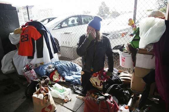 """""""The Swede"""", who has been homeless for 3 and 1/2 years, sits with some of his belongings after relocating due to the morning rain on 13th Street on Wednesday, January 6, 2015 in San Francisco, Calif."""