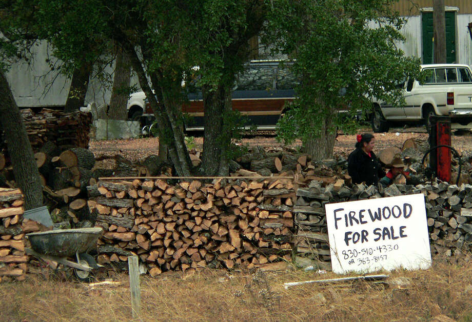 If you have a choice, obtain firewood that has dried (seasoned) for one summer since being chopped. Photo: Billy Calzada /San Antonio Express-News / SAN ANTONIO EXPRESS-NEWS