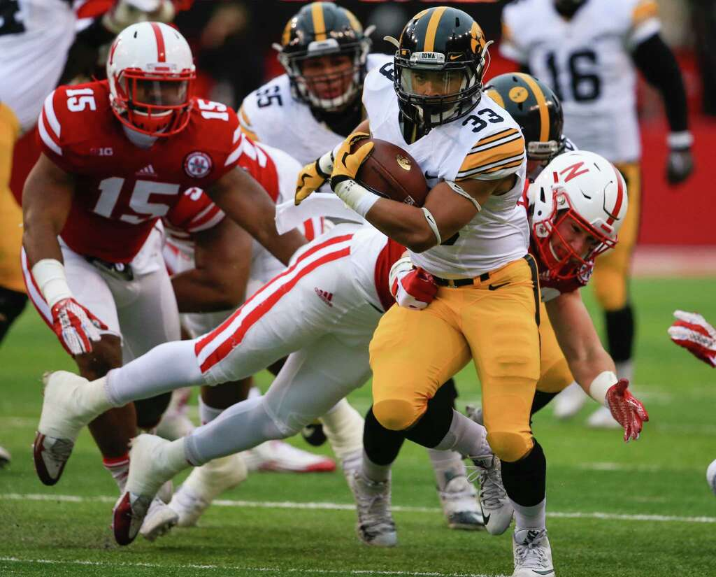 campus watch canzeri wraps up stellar career for iowa iowa running back canzeri 33 breaks a tackle by nebraska linebacker chris weber