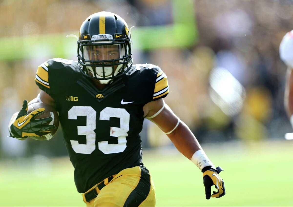 FILE - In this Oct. 10, 2015, file photo, Iowa running back Jordan Canzeri runs away an Illinois defender during the second half of an NCAA college football game in Iowa City, Iowa. Iowa reached its first Rose Bowl in 25 years despite a series of injuries. An extended rest should help players like Canzeri get ready for the Hawkeyes biggest game in years. (AP Photo/Justin Hayworth, File) ORG XMIT: NY163