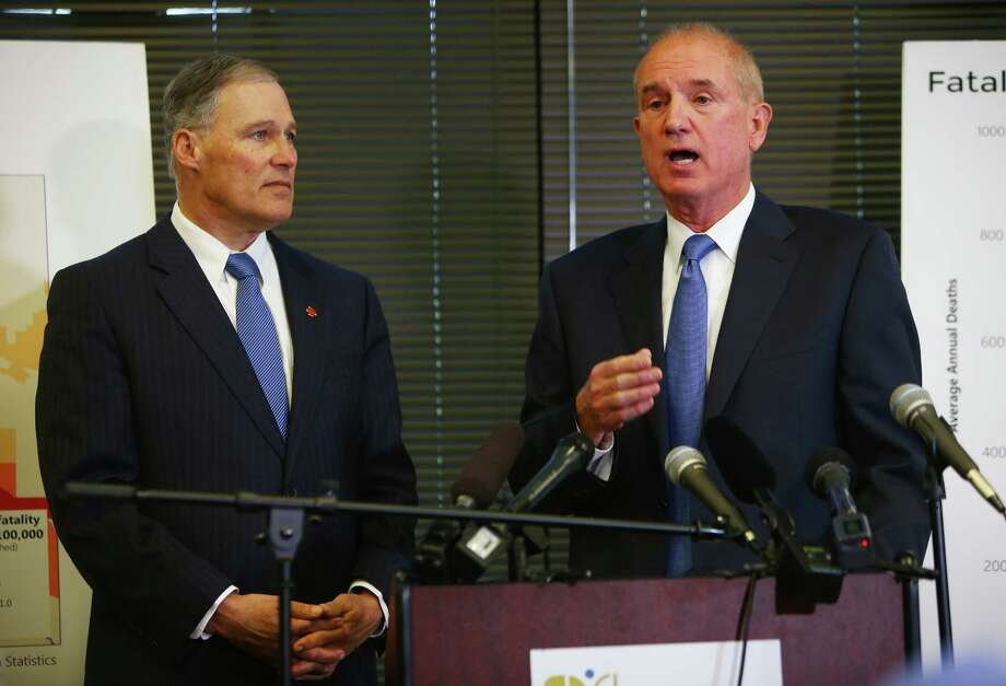 FILE -- King County Sheriff John Urquhart, at right with Gov. Jay Inslee, filed a defamation lawsuit against  an ex-deputy who accused him of sexual assault after a dinner outing in  2014. Photo: GENNA MARTIN, SEATTLEPI.COM / SEATTLEPI.COM