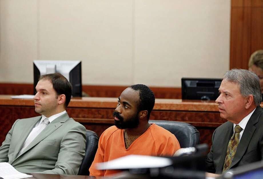 "Chimene Hamilton Onyeri center, with his attorneys  Sam Adamo, Jr. left, and  Sam Adamo, Sr. right, during a bond hearing on a murder charge in Judge Jan Krocker's 184th State District Court Wednesday, Jan. 6, 2016, in Houston. Onyeri is also a ""person of interest"" in the shooting of an Austin judge last year. Photo: James Nielsen, Houston Chronicle / © 2015  Houston Chronicle"