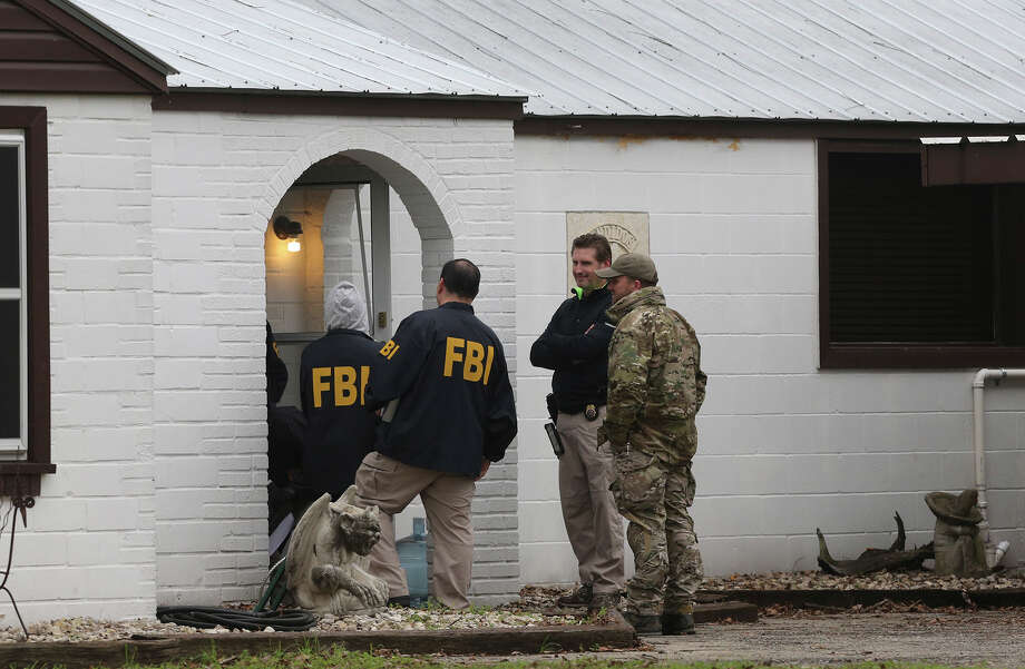 F.B.I. agents stand by the front door of a home located at 3003 Jupe Drive on San Antonio's South East Side where it is alleged that Bandidos Motocycle Club leader John X. Portillo lives. The agency said Portillo and the club's sergeant at arms, Justin Cole Forster, were taken into custody in San Antonio. Photo: John Davenport, Staff / San Antonio Express-News / ©San Antonio Express-News/John Davenport