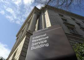 FILE - In this March 22, 2013 file photo, the exterior of the Internal Revenue Service (IRS) building in Washington. Got a question for the IRS on your taxes? Online may end up being the only answer. The IRS may soon dramatically scale back telephone and face-to-face service as part of a future plan that would focus more on online accounts for the 150 million individual taxpayers and 11 million businesses seeking help and information, the agency's official watchdog warned. (AP Photo/Susan Walsh, File)