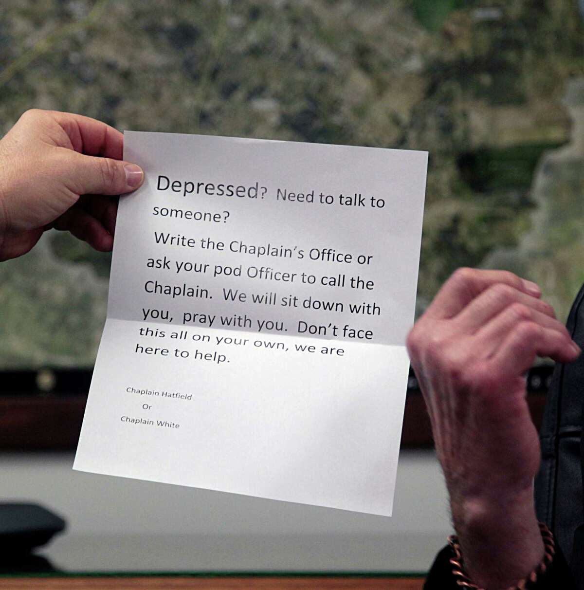 Fort Bend County Sheriff Troy Nehls holds a handout pamphlet for depression from the jail chaplain during an interview on recent suicides in the county's jail in Richmond. (James Nielsen / Houston Chronicle )