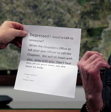 Fort Bend County Sheriff Troy Nehls holds a handout pamphlet for depression from the jail chaplain during an interview on recent suicides in the county's jail in Richmond.  (James Nielsen / Houston Chronicle ) Photo: James Nielsen, Staff / © 2015  Houston Chronicle