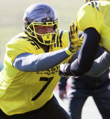 Army All-American Bowl east team defensive lineman Dexter Lawrence, left, is, at 6-foot-5, 335-pounds, among the nation's top high school football recruits. He has committed to play at Clemson. Photo: WILLIAM LUTHER, Staff / San Antonio Express-News / © 2016 San Antonio Express-News