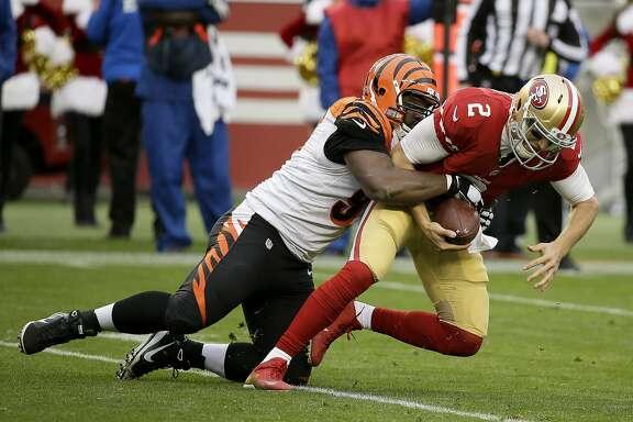 Cincinnati Bengals defensive tackle Geno Atkins, left, sacks San Francisco 49ers quarterback Blaine Gabbert during the first half of an NFL football game in Santa Clara, Calif., Sunday, Dec. 20, 2015. (AP Photo/Eric Risberg)