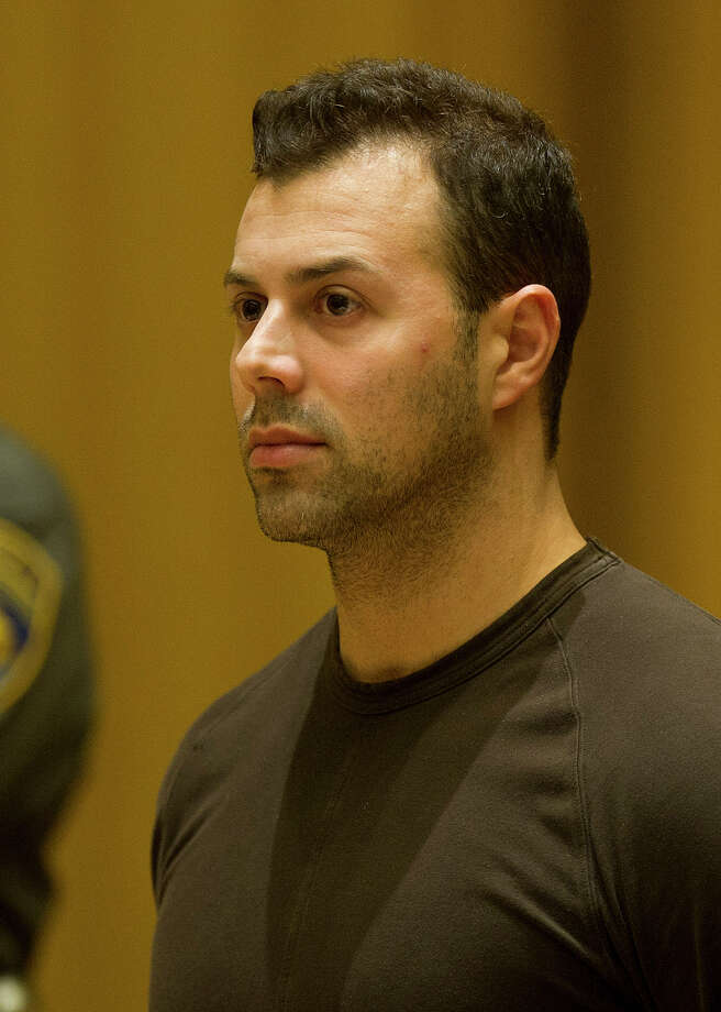 Anthony Manousos, 33, appears in state Superior Court in Stamford in 2014. He has been charged with setting fire to his rental property on Highland Road while two tenants were inside. Photo: Lindsay Perry / Hearst Connecticut Media / Stamford Advocate