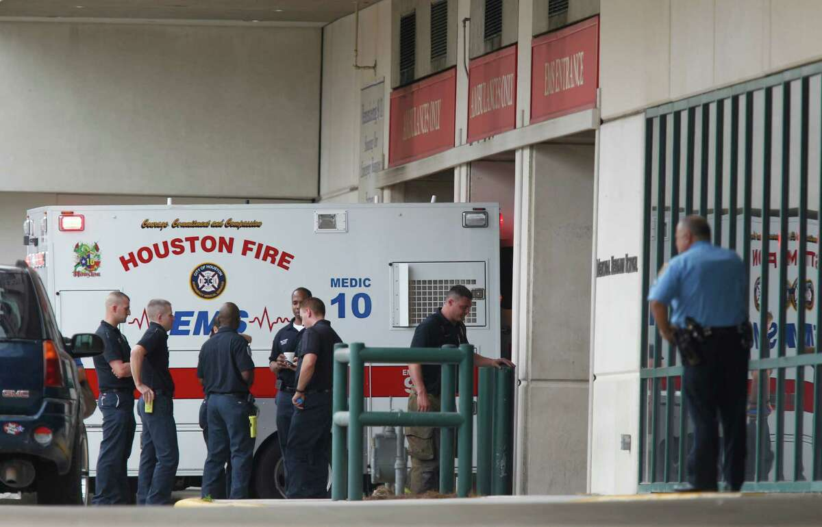 Emergency personnel outside ambulance bays at Memorial Hermann Hospital.