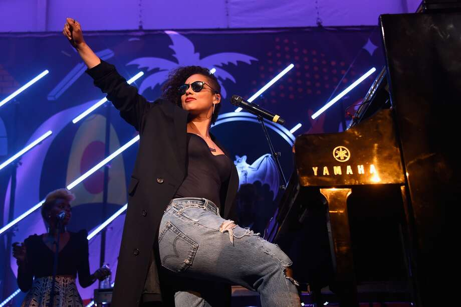 Singer Alicia Keys performs onstage at The Dean Collection X BACARDI Untameable House Party on December 3, 2015 in Miami, Florida. (Photo by Frazer Harrison/Getty Images for Bacardi)