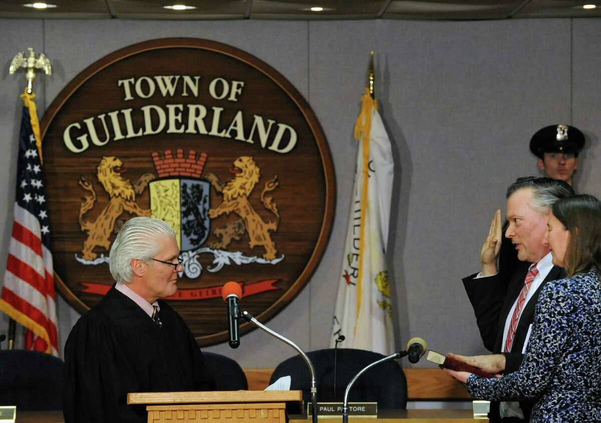 Town Supervisor Peter Barber, right, is sworn in by Judge Peter Lynch on Tuesday Jan. 5, 2016, in Guilderland, N.Y. (Michael P. Farrell/Times Union)