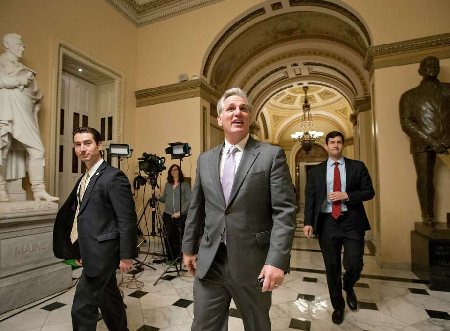 House Majority Leader Kevin McCarthy, R-Calif., smiles as he departs the chamber just after it voted to cut key parts of the Affordable Care Act and to stop taxpayer funds from going to Planned Parenthood. Photo: J. Scott Applewhite / Associated Press / AP