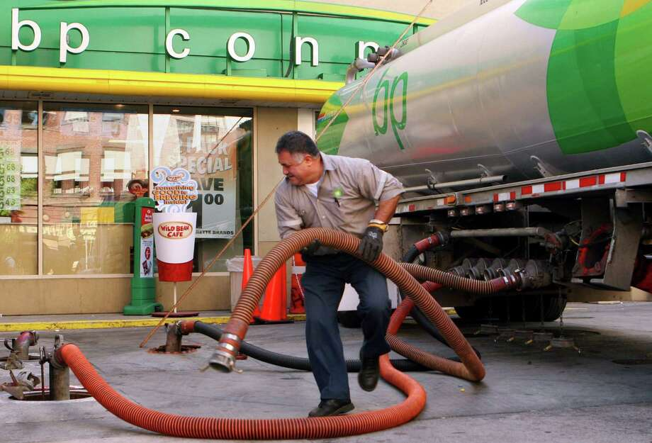 The U.S. Energy Information Administration said inventories of gasoline rose by 10.6 million barrels last week — the largest weekly increase in more than two decades. The news helped send U.S. crude oil down $2 at $33.97 a barrel. Photo: Associated Press File Photo / AP