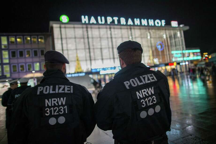 Police officers survey the area in front of the main train station in Cologne, Germany, where dozens of sexual assaults and robberies during New Year's Eve revelry have been reported. Photo: Maja Hitij /Getty Images / AFP