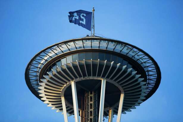 A Ken Griffey Jr. flag waves from the Space Needle to honor his commemoration into the National Baseball Hall of Fame, Wednesday, Jan. 2016.