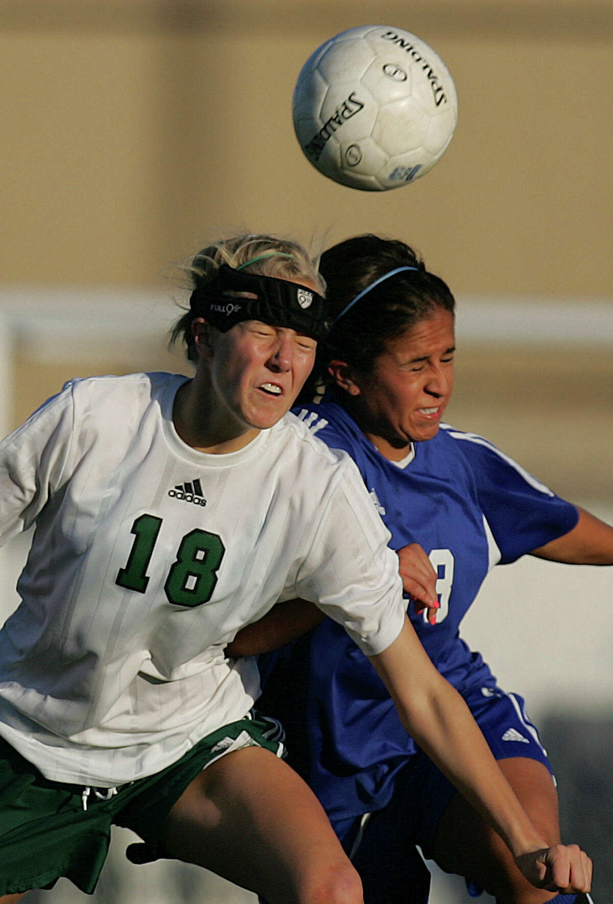 Reagan's Ashley Lachappelle and MacArthur's Manae Amaro fight for a header in the first half on Feb. 22, 2008 at Blossom Soccer Field West.