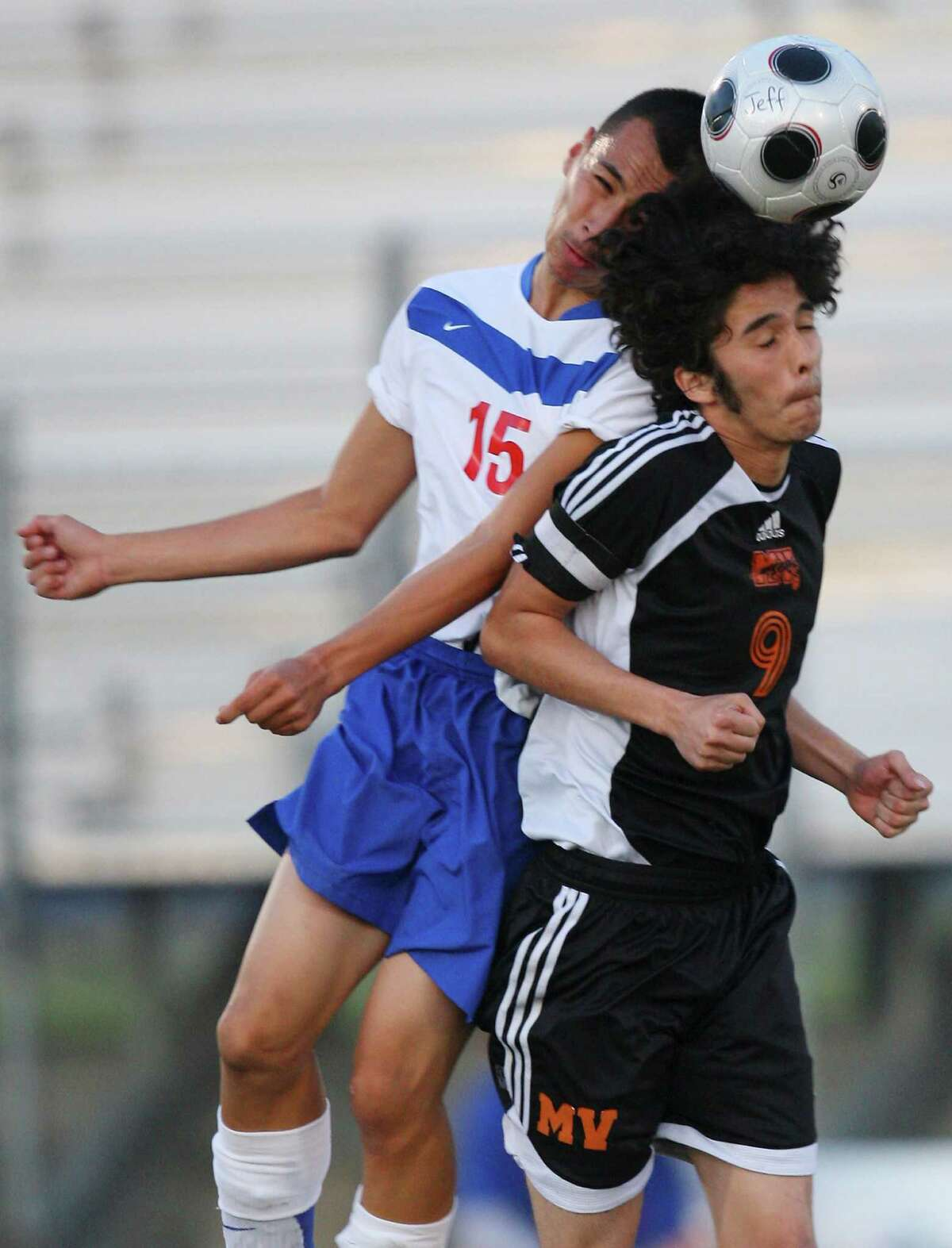 Jefferson's Ceasar Ramirez (left) and Medina Valley's Christian Moreno go up for a header during first half action on March 20, 2009.