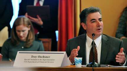 Troy Oechsner, special assistant to the superintendent, New York State Department of Financial Services talks about the collapse of the health exchange co-op known as Health Republic during a Senate Standing Committees on Health Insurance Roundtable on Wednesday, Jan. 6, 2016 at the Capitol in Albany New York.   (Paul Buckowski / Times Union)