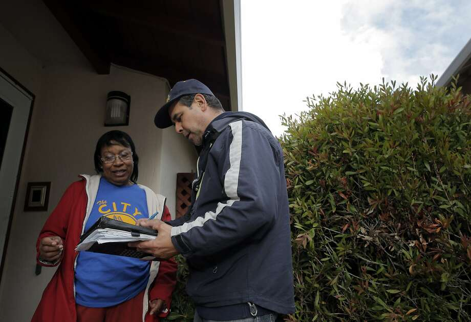 Ricardo Molina of Mr. Roofers, gives Novella Jefferson an estimate on a skylight replacement at her home in San Bruno, Calif., on Wednesday, January 6, 2016.  Some businesses have seen up uptick in work due to the arrival of storms from El Niño. Photo: Carlos Avila Gonzalez, The Chronicle